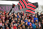 Exeter fans waving large flags before the Sky Bet League 2 match between Yeovil Town and Exeter City at Huish Park, Yeovil, England on 9 April 2016. Photo by Graham Hunt.