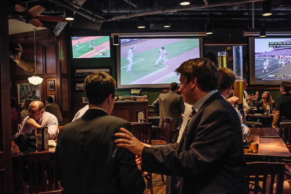 Patrons at Blackfin in Washington D.C. watch the Nationals play the Marlins on Thursday, Sept. 18, 2014. The Nationals and Orioles clinched the first two post season spots within hours of one another.