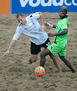 09 December 2006, South Africas Fani Shange fails to stop Englands captain Jamie O'Rourke from getting past him during their game at the Vodacom Pro Beach Soccer Tour in Durban's Bay of Plenty on Saturday. England won the game 3-1. Picture: Shayne Robinson, PhotoWire Africa