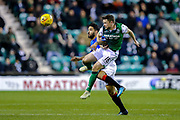 Lewis Stevenson (#16) of Hibernian leaps to win the header against Daniel Candeias (#21) of Rangers during the Ladbrokes Scottish Premiership match between Hibernian and Rangers at Easter Road, Edinburgh, Scotland on 19 December 2018.