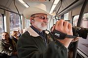 27 DECEMBER 2008 -- PHOENIX, AZ: At 9:50AM George Varrato (CQ) of Phoenix, video taped his first ride on the light rail. Metro Light Rail started running Saturday, Dec. 28. The light rail line is 20 miles long and cost $1.4 billion dollars. PHOTO BY JACK KURTZ