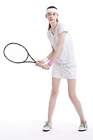 Portrait of young Caucasian woman with tennis racket against white background