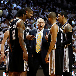Jun 18, 2013; Miami, FL, USA; San Antonio Spurs head coach Gregg Popovich talks with his team during the fourth quarter of game six in the 2013 NBA Finals against the Miami Heat at American Airlines Arena.  Mandatory Credit: Derick E. Hingle-USA TODAY Sports
