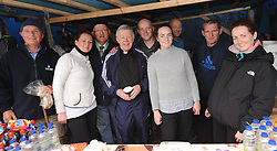 Archbishop of Tuam Dr Michael Neary enjoying a cuppa tea at Padraig Needham's stall on the summit of Croagh Patrick yesterday.<br />