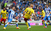 Watford Ben Watson free kick hits Brighton's Beram Kayal during the Sky Bet Championship match between Brighton and Hove Albion and Watford at the American Express Community Stadium, Brighton and Hove, England on 25 April 2015. Photo by Phil Duncan.