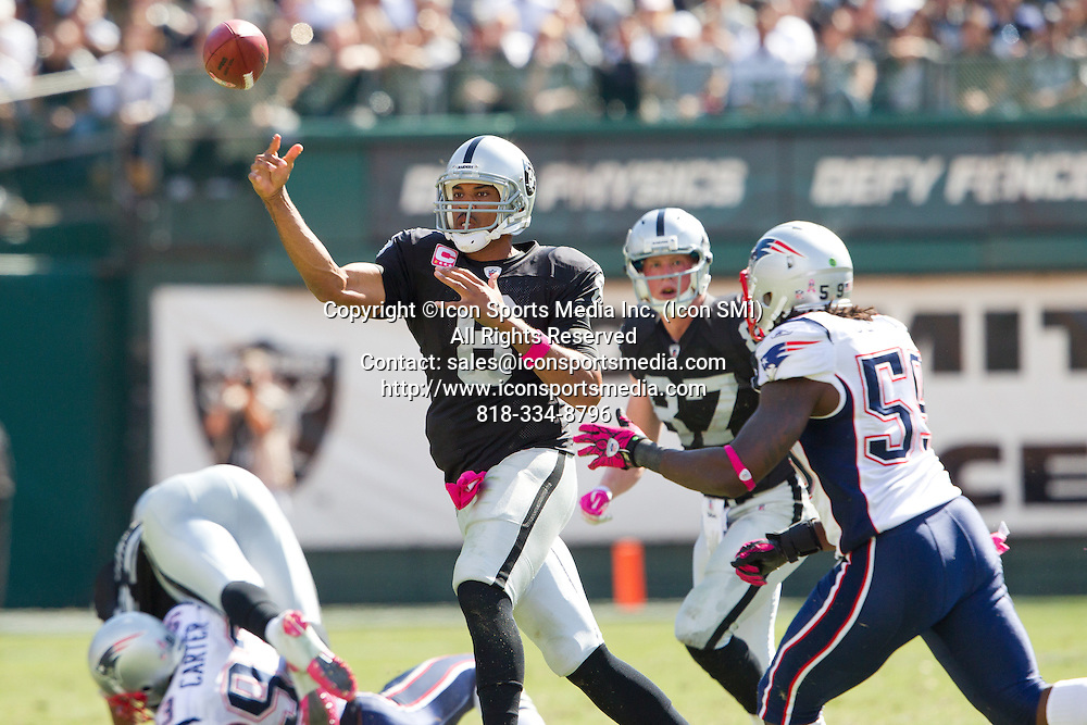 02 October 2011: Quarterback (8) Jason Campbell of the Oakland Raiders passes the ball against the New England Patriots during the first half of the Patriots 31-19 victory against the Raiders in an NFL football game at O.co Stadium in Oakland, CA.