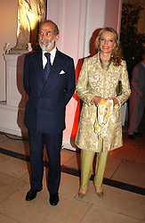 TRH PRINCE & PRINCESS MICHAEL OF KENT at a party to celebrattte the 150th anniversary of Kensington Palace Gardens in aid of the British Red Cross held at The Orangery, Kensington Palace, London on 7th July 2004.
