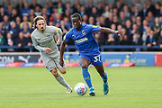 AFC Wimbledon defender Paul Osew (37) dribbling away from Portsmouth midfielder Ryan Williams (7) during the EFL Sky Bet League 1 match between AFC Wimbledon and Portsmouth at the Cherry Red Records Stadium, Kingston, England on 19 October 2019.