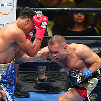 Sergei Lipinets punches Erick Bone during a Premier Boxing Champions fight on Saturday, August 4, 2018 at the Nassau Veterans Memorial Coliseum in Uniondale, New York.  (Alex Menendez via AP)
