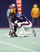 New York Giants linebacker Lawrence Taylor (56) takes a break during the NFL football game between the Los Angeles Rams and the New York Giants on September 22, 1985 in East Rutherford, New Jersey. The Giants won the game 27-17. ©Paul Anthony Spinelli