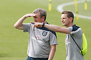 England manager Roy Hodgson and one of the England coaching staff during the England training session at Est&aacute;dio Claudio Coutinho, Rio de Janeiro, Brazil<br /> Picture by Andrew Tobin/Focus Images Ltd +44 7710 761829<br /> 21/06/2014