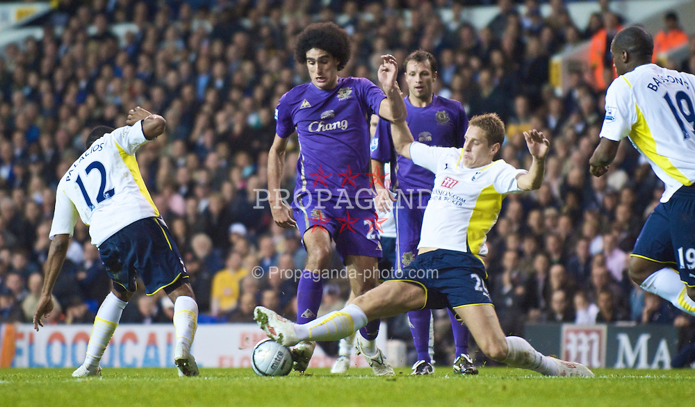 LONDON, ENGLAND - Tuesday, October 27, 2009: Everton's Marouane Fellaini and Tottenham Hotspur's Michael Dawson during the League Cup 4th Round match at White Hart Lane. (Photo by David Rawcliffe/Propaganda)