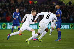 Swansea City's Alfie Mawson (left) celebrates scoring his side's first goal of the game during the Premier League match at the Liberty Stadium, Swansea.