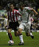 Photo: Paul Thomas.<br /> Leeds United v Sunderland. Coca Cola Championship. 13/09/2006.<br /> <br /> Liam Miller of Sunderland (L) tries to tackle Ian Westlake.