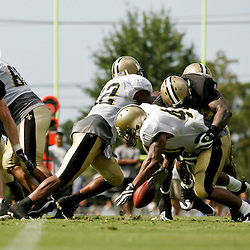 04 August 2009: New Orleans Saints defensive end Anthony Hargrove (69) forces running back Herb Donaldson (40) to fumble on a team drill during New Orleans Saints training camp at the team's practice facility in Metairie, Louisiana.