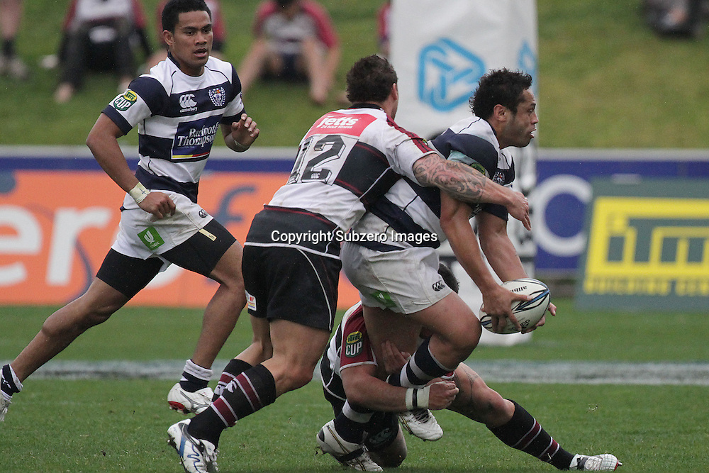Ben Atiga gets a pass away in the tackle of Luke McAlister. ITM Cup. North Harbour versus Auckland. North Harbour Stadium, Auckland, New Zealand. 1 August 2010. Photo: Gareth Cooke/Photosport