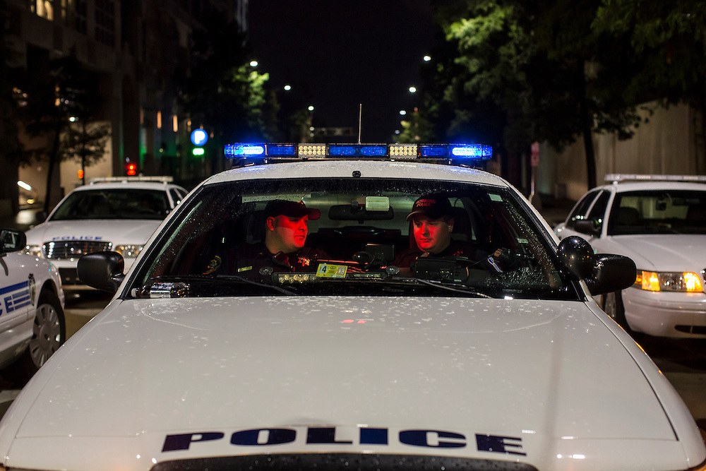 Police officers sit in their car ahead of the Democratic National Convention on Monday, September 3, 2012 in Charlotte, NC.