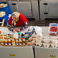 TIMISOARA, ROMANIA - APRIL 21:  A honey seller sit at her stall at the daily market on April 21, 2013 in Timisoara, Romania.  Romania has abandoned a target deadline of 2015 to switch to the single European currency and will now submit to the European Commission a programme on progress towards the adoption of the Euro, which for the first time will not have a target date. (Photo by Marco Secchi/Getty Images)