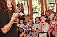 "Reptile Specialist Marie Leighton from ""Reptiles on the Move"" describes the blue tongued skink to children gathered at the Gilford Library Tuesday afternoon.  (Karen Bobotas/for the Laconia Daily Sun)Reptiles on the Move at Gilford Library."