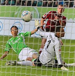 15.10.2011,Volkswagen Arena, Wolfsburg, GER, 1.FBL,VfL Wolfsburg vs 1. FC Nuernberg , im Bild . 1-1 durch Christian Eichler #8 gegen VfL TW Diego Benaglio #1 und Makoto Hasebe #13.  .// during the match from GER, 1.FBL, VfL Wolfsburg vs 1. FC Nuernberg  on 2011/10/15, Volkswagen Arena, Wolfsburg, Germany..EXPA Pictures © 2011, PhotoCredit: EXPA/ nph/  Rust       ****** out of GER / CRO  / BEL ******