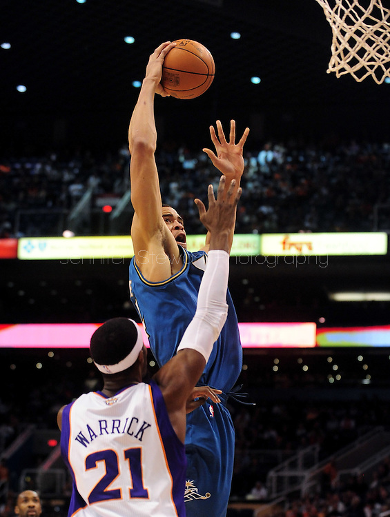Dec. 5 2010; Phoenix, AZ, USA; Washington Wizards center JaVale McGee (34) puts up a basket during the first half against Phoenix Suns forward Hakim Warrick (21) at the US Airways Center. The Suns defeated the Wizards 125-108. Mandatory Credit: Jennifer Stewart-US PRESSWIRE.
