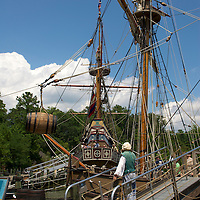 Hoisting barrels on the life-size reproduction of the ship Discovery.