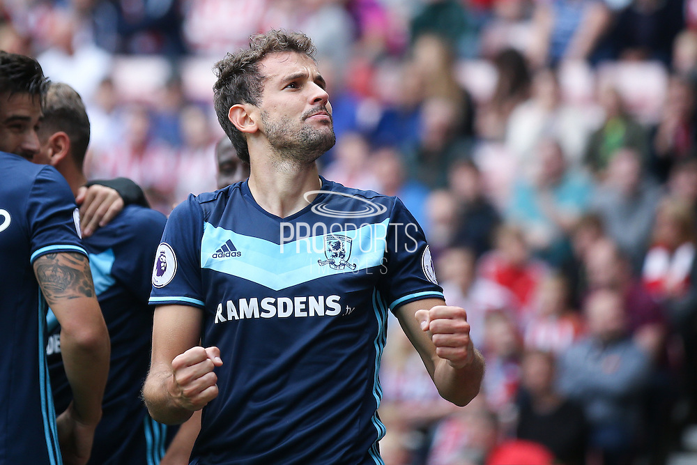 Middlesbrough forward Christian Stuani (18) scores a goal and celebrates to make the score 0-1 during the Premier League match between Sunderland and Middlesbrough at the Stadium Of Light, Sunderland, England on 21 August 2016. Photo by Simon Davies.