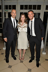 Left to right, IVAN GAZIDIS chief executive of Arsenal FC, his wife MAUREEN SMITH and German World Cup football winner LUKAS PODOLSKI at 'A Night of Champions' an evening to raise funds for the Mo Farah Foundation held at The Hurlingham Club, London on 28th August 2014.