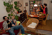 Michael Sturm family at suppertime in Hamburg, Germany. They were photographed for the Hungry Planet: What I Eat project with a week's worth of food. Model Released.