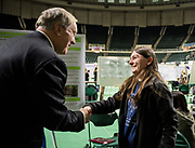 Allison Cooks shakes hands with Ohio University President Duane Nellis during the 2018 Student Research Expo.
