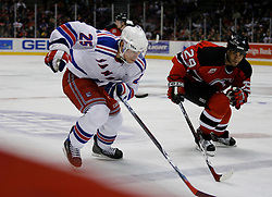 Feb 20, 2007; East Rutherford, NJ, USA; New York Rangers center Petr Prucha (25) and New Jersey Devils defensman Johnny Oduya (29) race for the puck during the third period at Continental Airlines Arena in East Rutherford, NJ.