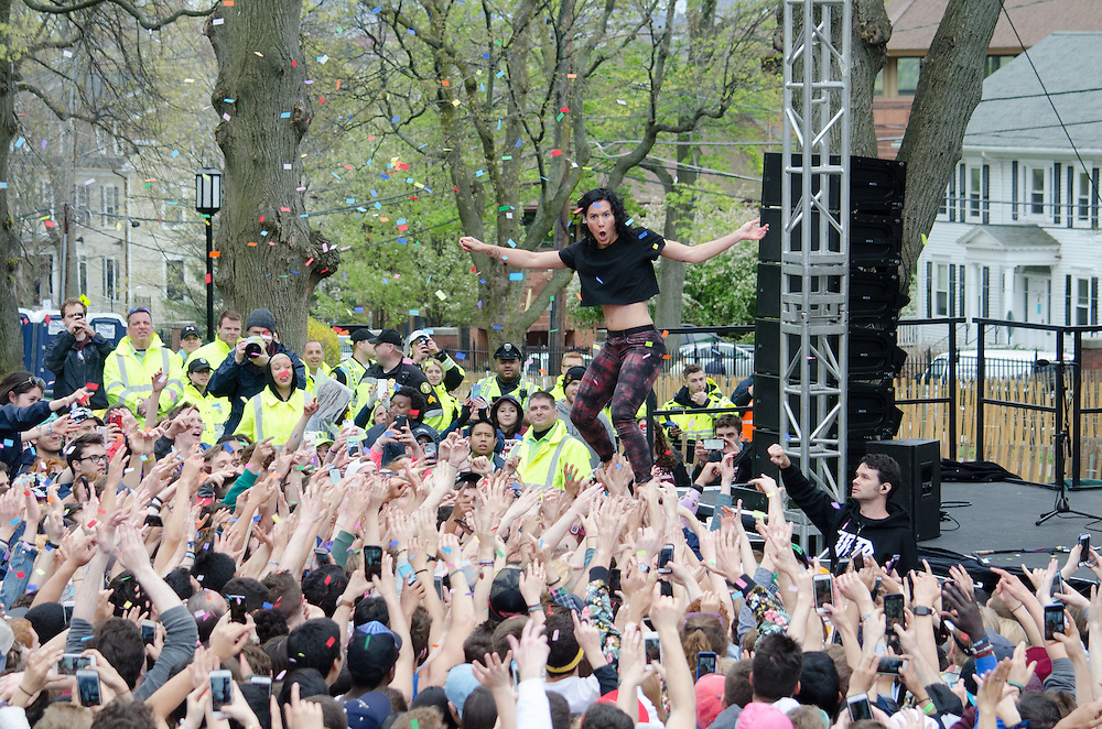 2016-05-01-Medford/Somerville-Tufts University-President's Lawn-The audience holds up Kim after Matt throws confetti into the air (Alex Knapp / The Tufts Daily).