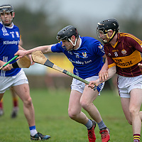 Kilmaley's Michael O'Malley is tackled by Tulla's Colm McInerney