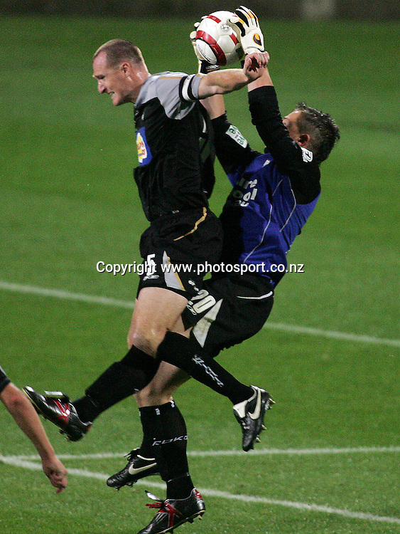 Danny Hay gets caught up with Danny Vukovic during the A-League Soccer match between the New Zealand Knights and the Central Coast Mariners at North Harbour Stadium, Auckland, New Zealand on Saturday 29 October, 2005. The Mariners won the match 3 - 1. Photo: Hannah Johnston/PHOTOSPORT