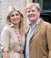 King Willem and Queen Maxima with their children attend a photocall at their home near The Hague in Holland.