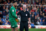 Referee Kevin Johnson shares a laugh with Shrewsbury Town goalkeeper Steve Arnold (15) during the EFL Sky Bet League 1 match between Peterborough United and Shrewsbury Town at London Road, Peterborough, England on 23 February 2019.