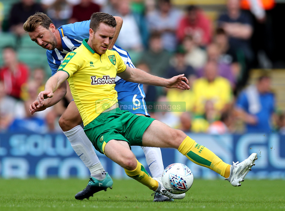 Norwich City's Marley Watkins (front) is challenged by Brighton's Dale Stephens during the pre-season match at Carrow Road, Norwich.