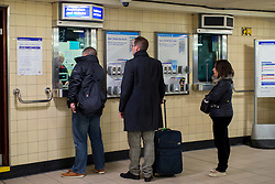 © licensed to London News Pictures. London, UK 21/11/2013. Tube passengers queuing outside ticket offices at Leicester Square Tube Station on Thursday, November 21, 2013. TfL reveals the plans to shut London Tube ticket offices and cut 750 jobs by 2015 due to cuts of about £78m. Photo credit: Tolga Akmen/LNP