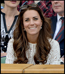 Image ©Licensed to i-Images Picture Agency. 02/07/2014. London, United Kingdom. The Duke and Duchess of Cambridge pull a face as Andy Murray is beaten by Grigor Dimitrov in the Men's  Quarter Finals on centre court in the Royal box at  Wimbledon. Picture by Andrew Parsons / i-Images