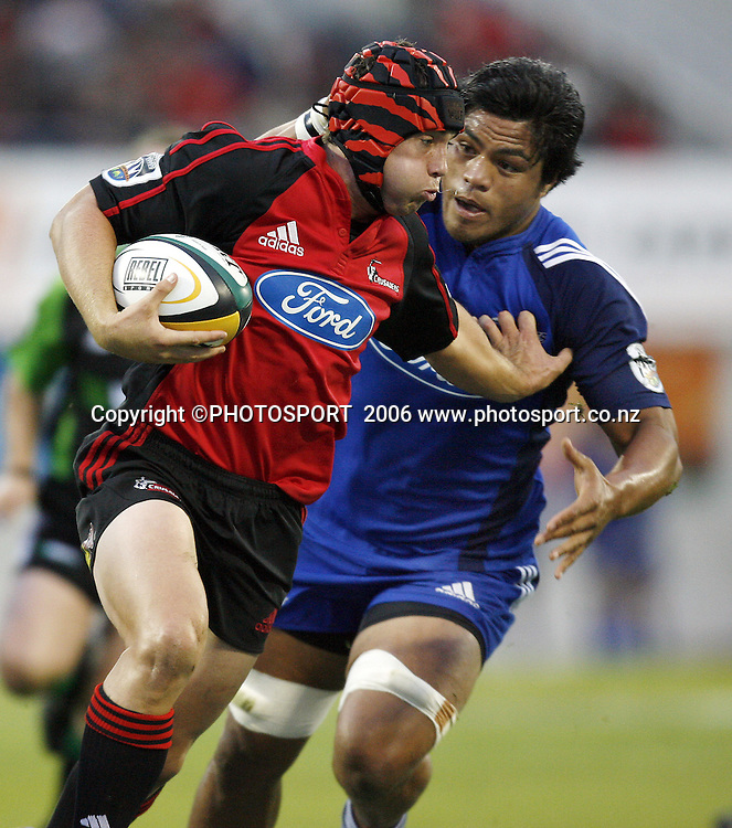 Cameron McIntyre fends off Kevin O'Neill during the 2006 Super 14 Rugby Union match between the Crusaders and the Blues at Jade Stadium, Christchurch, on Saturday 4 March 2006. Photo: Anthony Phelps/PHOTOSPORT