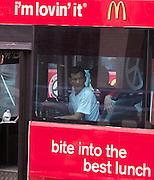 Malaysia, Kuala Lumpur. Public bus with McDonald's ad.