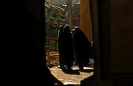 Residents make their way through the Old City  May 5, 2005 in Kabul, Afghanistan. The Afghan government is struggling to decide whether to modernize much of the destroyed or try to rebuild and preserve the architecture of traditional areas.<br />