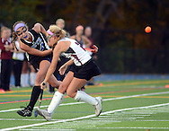 AMBLER, PA -  NOVEMBER 2:  Central Bucks South's Mackenzie Harding (4) makes a pass as West Chester Henderson's Ryann Bauer (2) defends during the District One Class AAA field hockey championship game November 2, 2013 in Ambler, Pennsylvania. Central Bucks South lost to West Chester Henderson 1-0. (Photo by William Thomas Cain/Cain Images)
