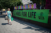 Extinction Rebellion on day 2 of their activities in central London, their blue boat opposite the Old Vic theatre near Waterloo and their encampment on Waterloo Millennium Green at the end of Lower Marsh, London, Great Britain <br /> 16th July 2019 <br /> <br /> Photograph by Elliott Franks