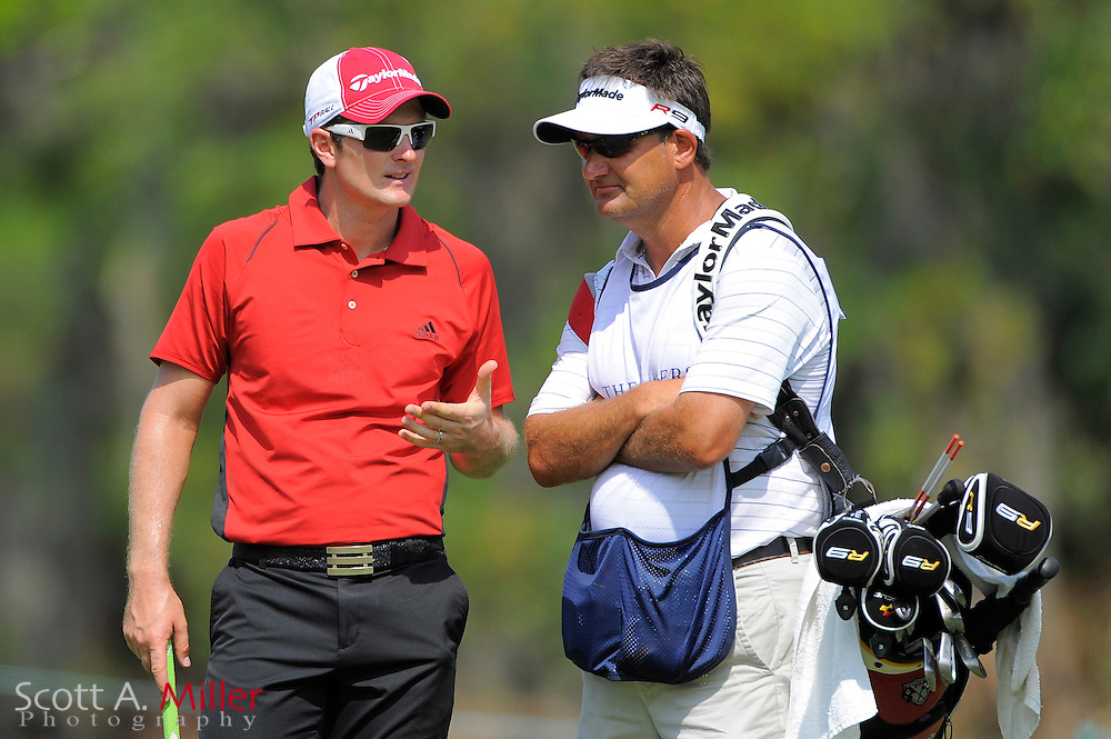 Justin Rose talks to his caddie on the seventh hole during the first round of the Players Championship at TPC Sawgrass on May 7, 2009 in Ponte Vedra Beach, Florida.     ©2009 Scott A. Miller