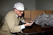 CEO Georg Gundersen holding a handfull of loose snus at his Danish snus factory AG Snus, a subsidiary of Assens Tobaccofactory. PHOTO: ERIK LUNTANG / INSPIRIT Photo.
