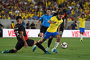 Brazil midfielder Phillippe Coutinho (11) is defended by Peru defender Carlos Zambrano (15) during an international friendly soccer match, Tuesday, Sept. 10, 2019, in Los Angeles. Peru defeated Brazil 1-0.