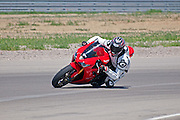 Elijah Weber racing his Triumph 675 at the Miller Motor Sports Park track in the city of Tooele in northern Utah