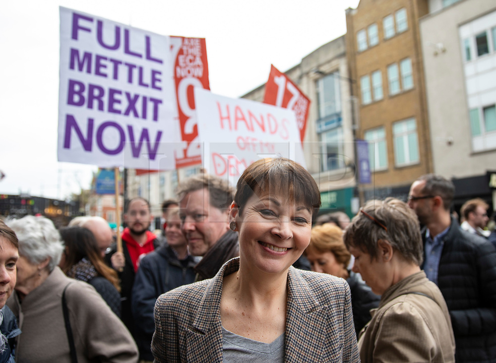 © Licensed to London News Pictures. 15/04/2018. London, UK. Co-Leader of the Green Party CAROLINE LUCAS passes pro-Brexit protesters as she arrives at Electric Ballroom in Camden for the launch event for the People's Vote campaign which is calling for a public vote on the final Brexit deal. Photo credit: Rob Pinney/LNP