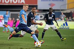 September 5, 2018 - Bronx, New York, United States - New York City defender ANTON TINNERHOLM #3 shoots on goal defended by New England Revolution midfielder BRANDON BYE #15 during a regular season match at Yankee Stadium in Bronx, NY.  New England Revolution defeats New York City FC 1 to 0 (Credit Image: © Mark Smith/ZUMA Wire)